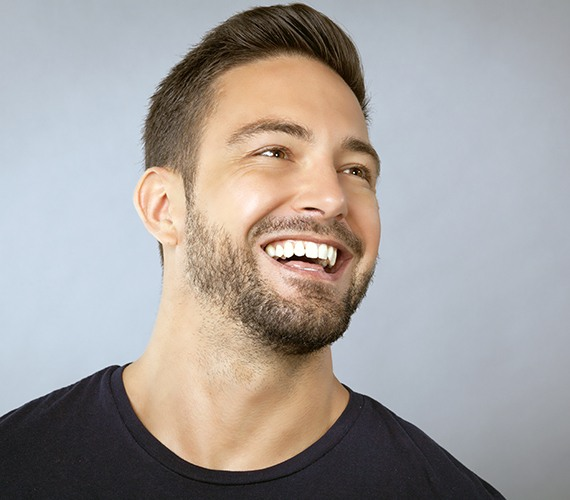 Man's smile after metal free dental restoration