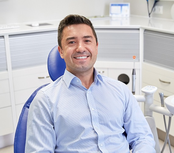 Man smiling after preventive dentistry checkup