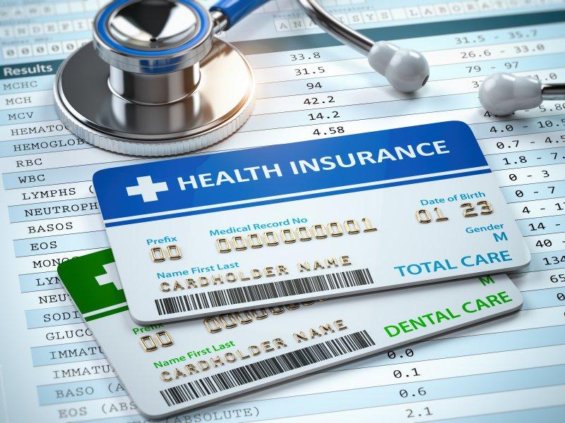 Health insurance card on top of dental card